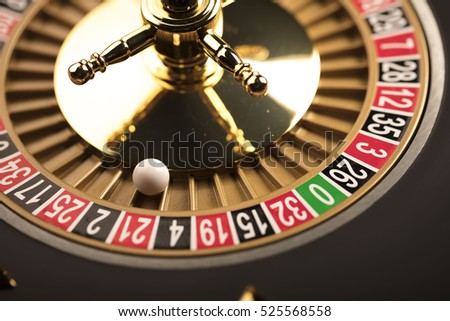Casino theme. Golden roulette wheel closeup.