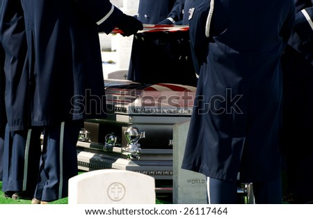 Casket at military funeral at Arlington National Cemetery with American flag reflected on casket - stock photo