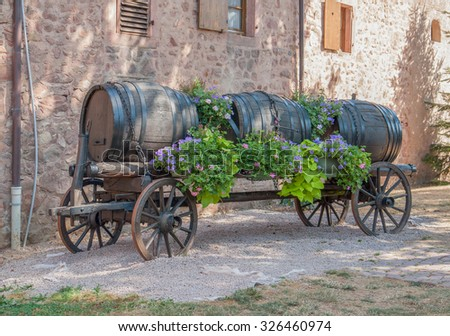 casks on a carriage in Riquewihr, a town in Alsace, France - stock photo