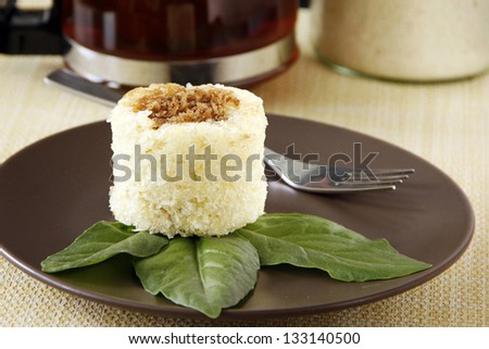 Cassava cake top with sweet grated coco meat breakfast with tea - stock photo