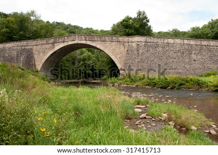 Casselman Bridge, a stone arch bridge built in 1813, located in Casselman River Bridge State Park, Garrett County, Maryland; a National Historic Landmark