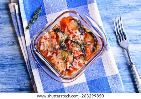 Casserole of eggplant and tomato with cheese in portions glass form - stock photo