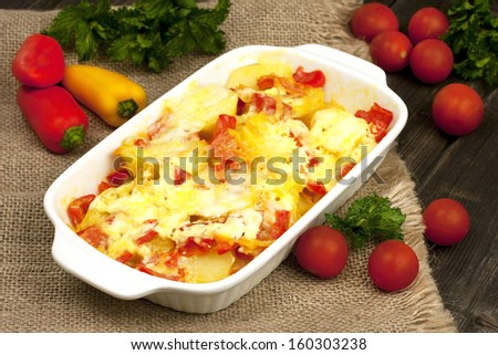 Casserole of potatoes  with zucchini and carrots and cheese  - stock photo