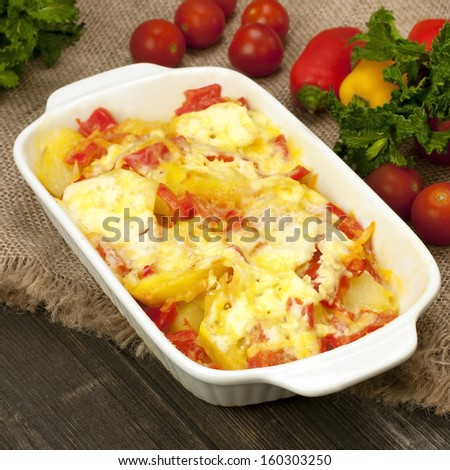 Casserole of potatoes  with zucchini and carrots and cheese