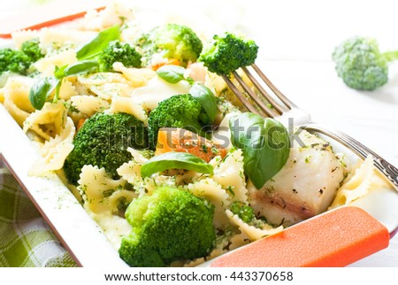 Casserole pasta with fish and broccoli with cream sauce and cheese with garlic. Summer dish. - stock photo