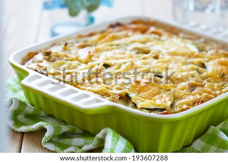 casserole with cabbage and zucchini in baking dish - stock photo
