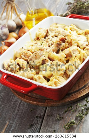 Casserole with cauliflower, chicken and cheese in a ceramic pot