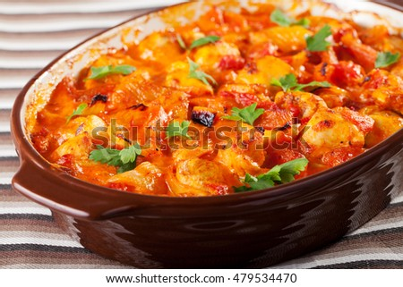Casserole with chicken, potatos and tomatos in a baking dish, ready-to-eat