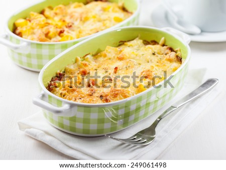 Casserole with pasta and cheese with herbs - stock photo