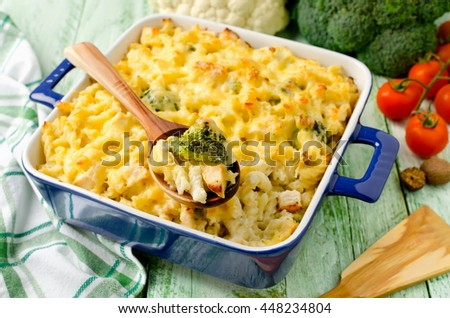 Casserole with pasta, chicken, broccoli and Bechamel sauce under a cheese crust - stock photo