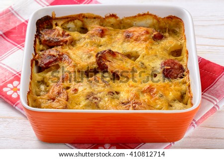Casserole with potatoes, sausages, tomatoes and cheese.