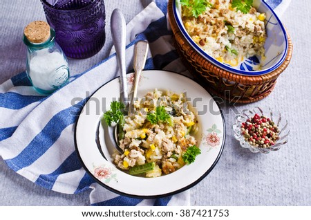 Casserole with rice, vegetables and minced meat. Selective focus.