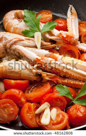 casserole with scampi and tomatoes close up