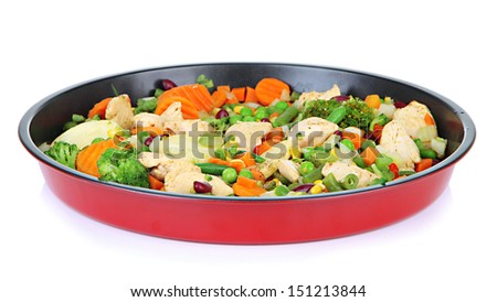 Casserole with vegetables and meat on pan, isolated on white - stock photo