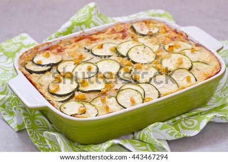 casserole with zucchini, corn, potato and cream in baking dish - stock photo