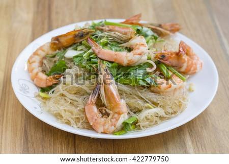 Casseroled prawns/shrimps with glass noodles, Thai food. - stock photo