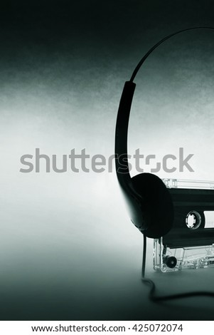 cassette and headphones - stock photo
