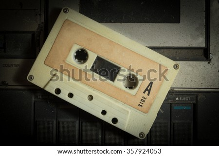 Cassette tape on dusty retro player.