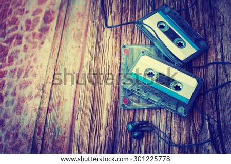 Cassette tapes over wooden table. top view. - stock photo