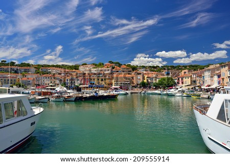 CASSIS, FRANCE - JUL R 14, 2014: A picturesque tourist port in the south of France called Cassis. Cassis is a famous port where tourists charter boats to view the calanques.