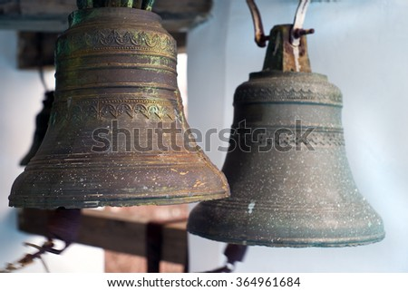 Cast-iron ancient bells of orthodox church, close up - stock photo