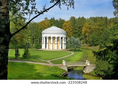 cast iron bridge and the Temple of Friendship in Pavlovsk Park (1780), Saint Petersburg, Russia - stock photo