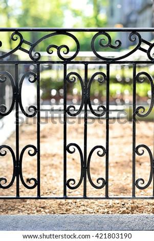 Cast iron fence detail - stock photo