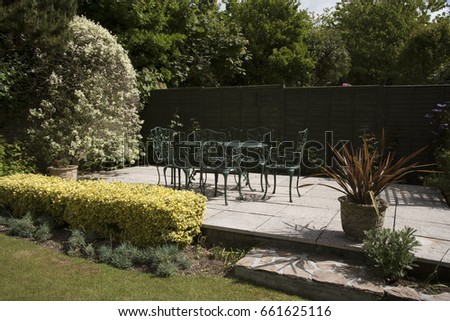 cast iron garden furniture a table and chairs painted dark green devon england uk - Garden Furniture 2017 Uk