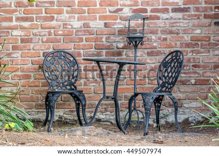 Cast Iron Garden Furniture Suit Next To Brick Wall