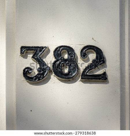 Cast iron house number three hundred and eighty two - stock photo