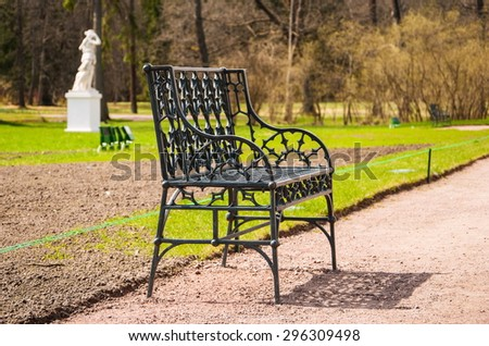 Cast iron openwork bench at the park's walkway