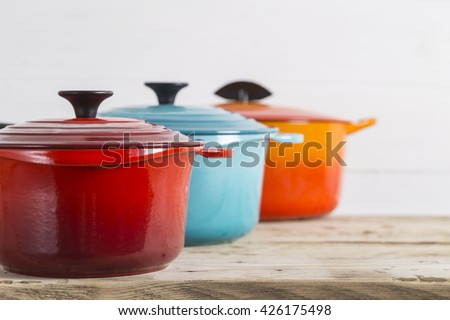 Cast iron saucepans and pot - stock photo