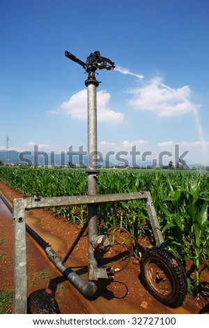 Castegnato (Bs),Franciacorta,Lombardy,Italy,plant artificial irrigation in a cornfield in June - stock photo
