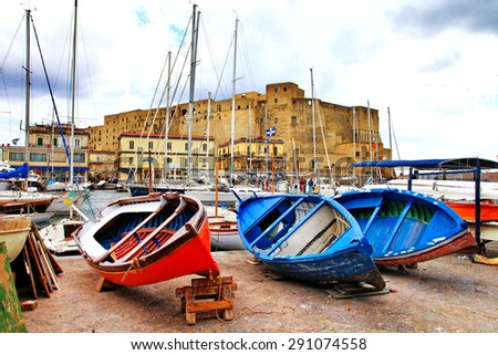 Castel dell'Ovo and old boats. Naples, Italy - stock photo