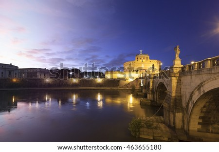 Castel Sant Angelo and the Sant Angelo bridge in Rome sunset and twilight transition illuminated by night. Also known as the Mausoleum of Hadrian.