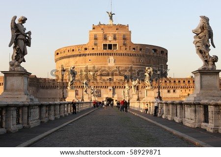 Castel Sant'Angelo at sunset with tourists - no face can be identified. - stock photo