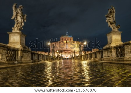 Castel Sant'Angelo in Rome, Italy, illuminated by the night lamps - stock photo