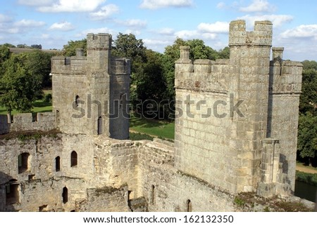 castellated towers of a ruined castle - stock photo