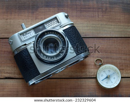 Castellon,Spain.November 22,2014,Old style reflex camera with a compass on a wooden surface - stock photo