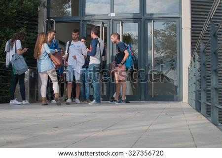 "CASTELLON, SPAIN - OCTOBER 2015 - Students coming out of ""Jaume I ""University in Castellon - stock photo"