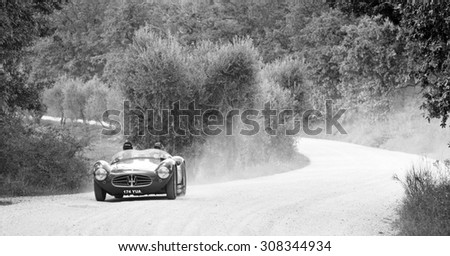 CASTELNUOVO BERARDENGA (SI), ITALY - SEPTEMBER 20: A Maserati A6GCS takes part to the GP Nuvolari classic car race on September 20, 2014 in Castelnuovo Berardenga (SI). The car was built in 1954 - stock photo