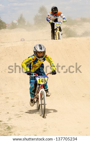 CASTELO BRANCO, PORTUGAL - MAY 5: Bernardo Tomas followed by Iuri Teixeira at the 3rd stage of the Luso-Spanish BMX race Trophy the  on may 5, 2013 in Castelo Branco, Portugal.
