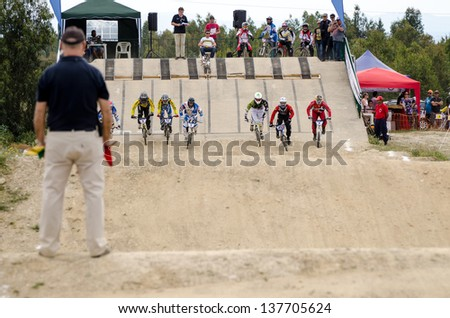 CASTELO BRANCO, PORTUGAL - MAY 5: Elite race start at the 3rd stage of the Luso-Spanish BMX race Trophy the  on may 5, 2013 in Castelo Branco, Portugal.
