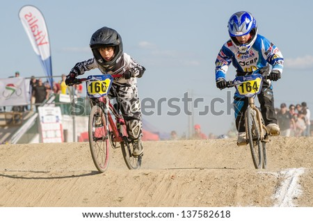 CASTELO BRANCO, PORTUGAL - MAY 4: Francisco Sousa followed by Andre Ribeiro at the 2nd stage of the Portuguese BMX race Cup the  on may 4, 2013 in Castelo Branco, Portugal. - stock photo
