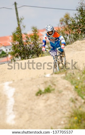 CASTELO BRANCO, PORTUGAL - MAY 5: Joana Conceicao at the 3rd stage of the Luso-Spanish BMX race Trophy the  on may 5, 2013 in Castelo Branco, Portugal.