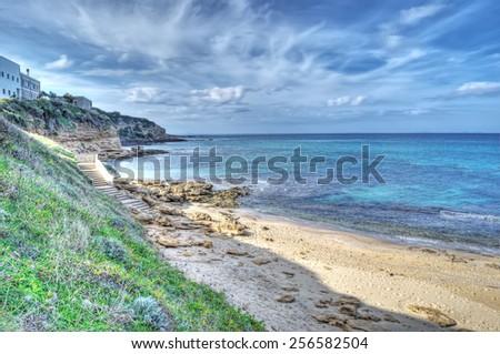Castelsardo shoreline in hdr tone mapping effect - stock photo