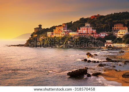 Castiglioncello sunset on cliff rock and sea. Tuscany, Italy, Europe - stock photo