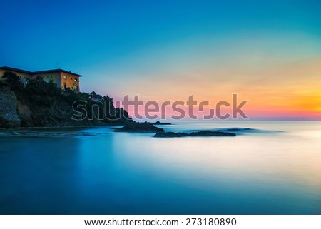Castiglioncello travel destination, old building on the rocks and sea on sunset. Tuscany, Italy, Europe. Long Exposure - stock photo