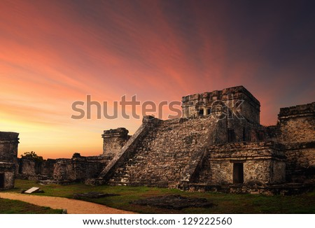 Castillo fortress at sunset in the ancient Mayan city of Tulum, Mexico - stock photo