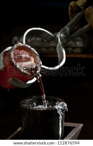 Casting metals - Pouring Liquid Aluminum - stock photo